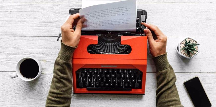 Red Typewriter, mug of black coffee
