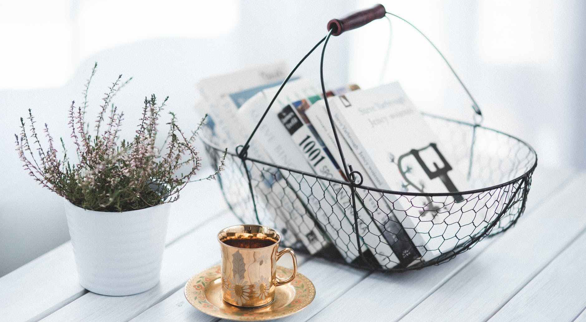 books in basket, golden cut, and potted plant